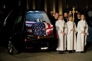 Military and civilian clergy stand by the casket of former President George H.W. Bush during the arrival ceremony at St. Martin's Episcopal Church where the former president will lie in repose, Wednesday, Dec. 5, 2018, in Houston.