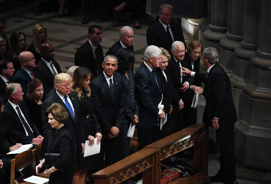 Former President George W. Bush talks with former President Jimmy Carter while President Donald Trump and first lady Melania Trump attend former President George H.W. Bush's funeral alongside their living predecessors at the National Cathedral in Washington on Wednesday, Dec. 5, 2018. Photo: Washington Post Photo By Matt McClain / The Washington Post