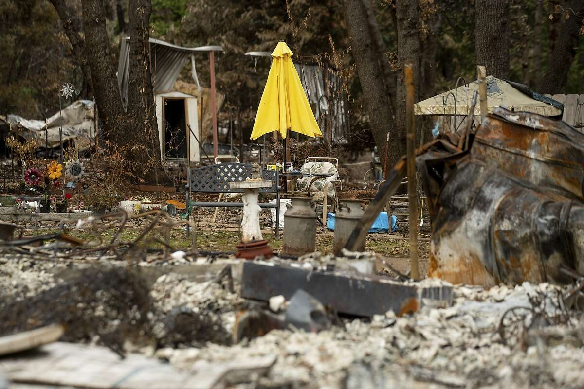 Following the Camp Fire, a patio umbrella stands among the wreckage of a Magalia, Calif., home on Tuesday, Dec. 4, 2018. (AP Photo/Noah Berger)