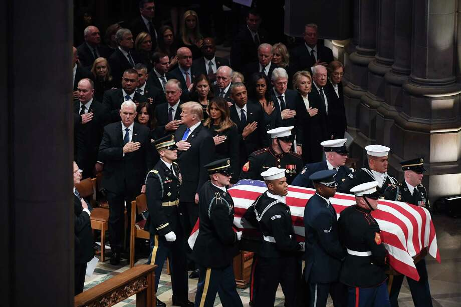 Servicemen carry the casket of Former President George H.W. Bush past Vice President Mike Pence and his wife, Karen; President Donald Trump and his wife, Melania; former President Barack Obama and his wife, Michelle; former President Bill Clinton and his wife, former Secretary of State Hillary Clinton; and former President Jimmy Carter and his wife, Rosalynn during the funeral at the National Cathedral in Washington on Wednesday, Dec. 5, 2018. Photo: Washington Post Photo By Matt McClain / The Washington Post