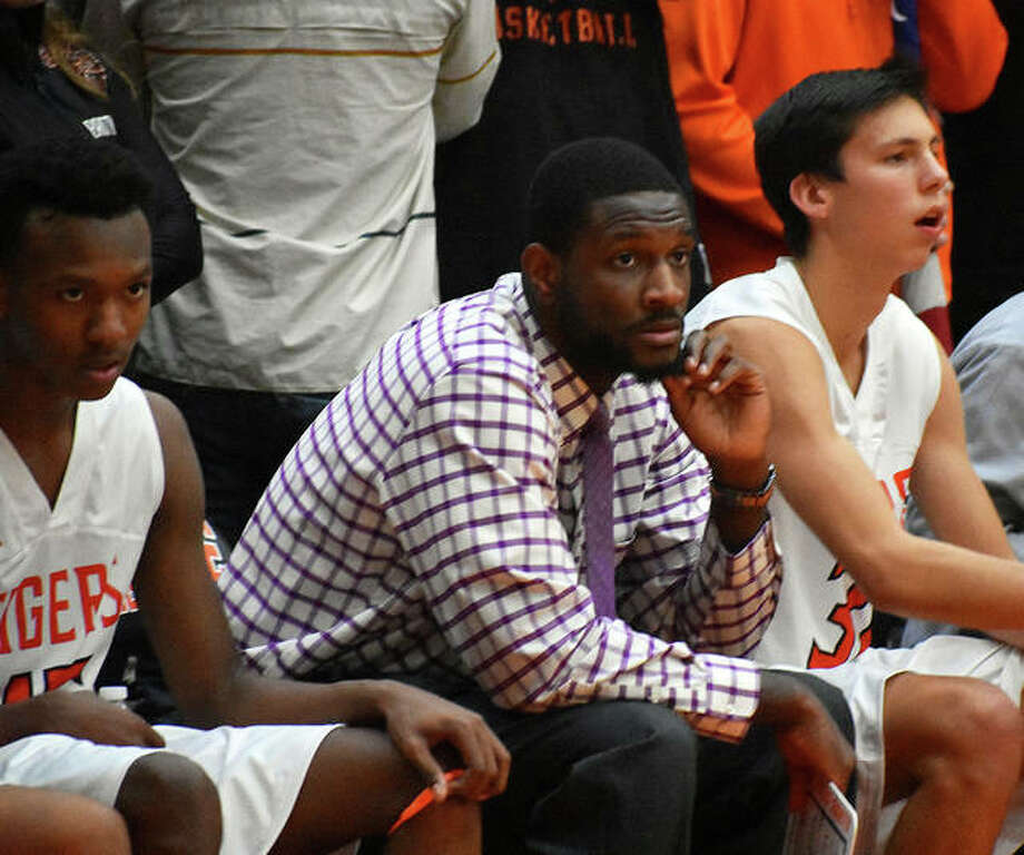 Edwardsville assistant coach Garret Covington, middle, watches the action during Tuesday's game against Belleville East at Lucco-Jackson Gymnasium. Covington, a 2013 EHS graduate, is a new member of the coaching staff under first-year head coach Dustin Battas. Photo: Matt Kamp/Intelligencer