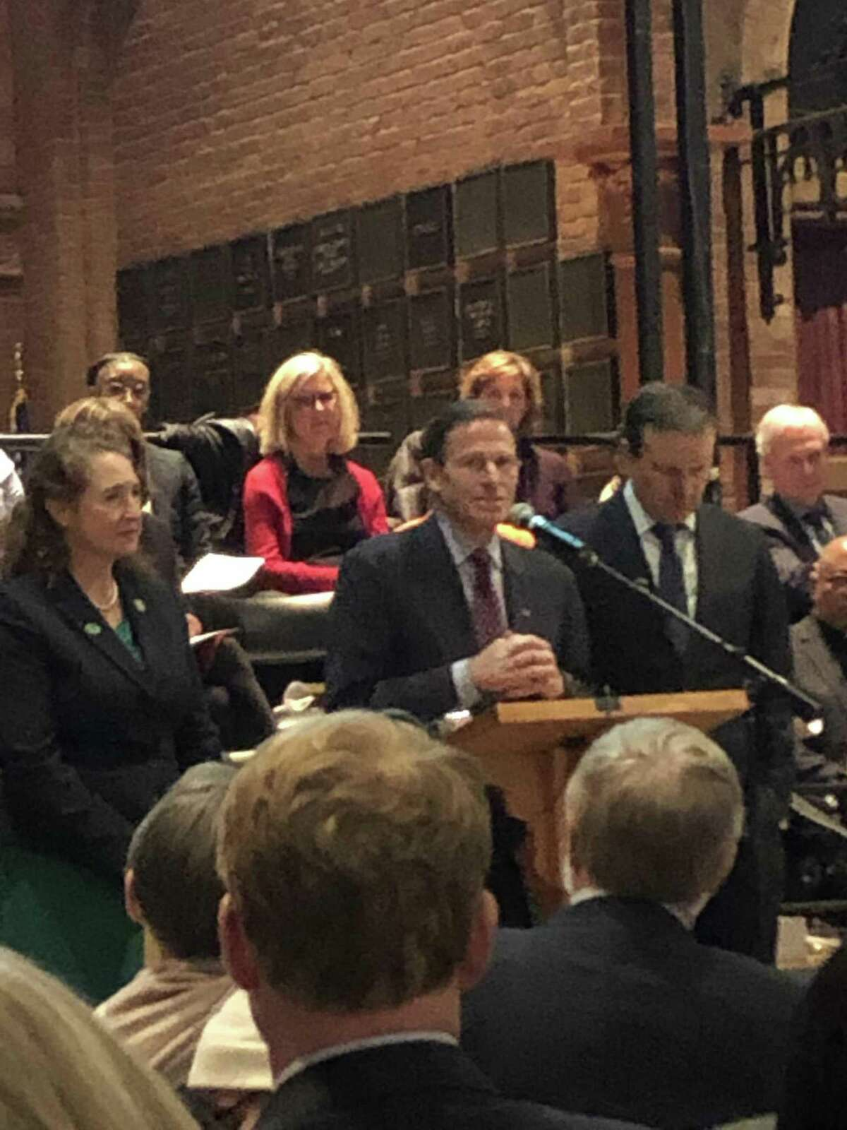 Connecticut's Democratic contingent from left Rep. Elizabeth Esty, Sen. Richard Blumenthal and Sen. Chris Murphy were guests at the vigil to honor the victims of gun violence on the sixth anniversary of the Sandy Hook massacre.