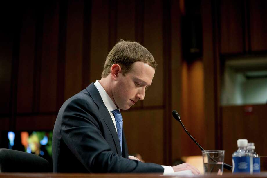 FILE- In this April 10, 2018, file photo Facebook CEO Mark Zuckerberg pauses while testifying before a joint hearing of the Commerce and Judiciary Committees on Capitol Hill in Washington about the use of Facebook data to target American voters in the 2016 election. The British Parliament has released some 250 pages worth of documents that show Facebook considered charging developers for data access. The documents show internal discussions about linking data to revenue. (AP Photo/Andrew Harnik, File) Photo: Andrew Harnik / Copyright 2018 The Associated Press. All rights reserved.