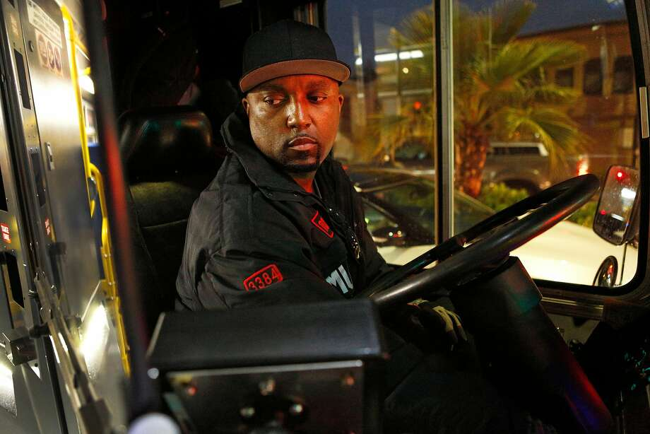 Terry Warmsley, who has driven 11 years for Muni, watches his passengers as they step off his 27-Bryant bus. Photo: Santiago Mejia / The Chronicle