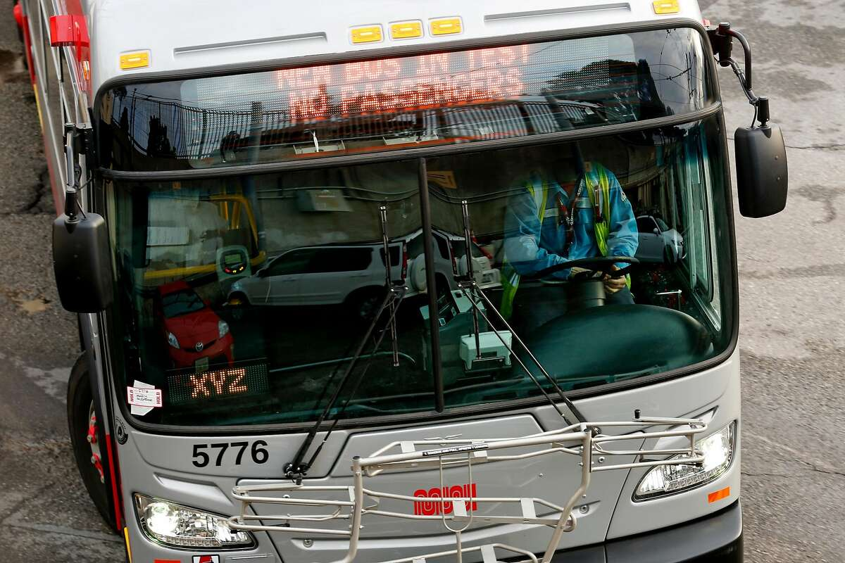"""The sign reads """"New bus in test No passengers"""" on a bus at the MUNI Potrero Division yard on Wednesday, Dec. 5, 2018, in San Francisco, Calif."""