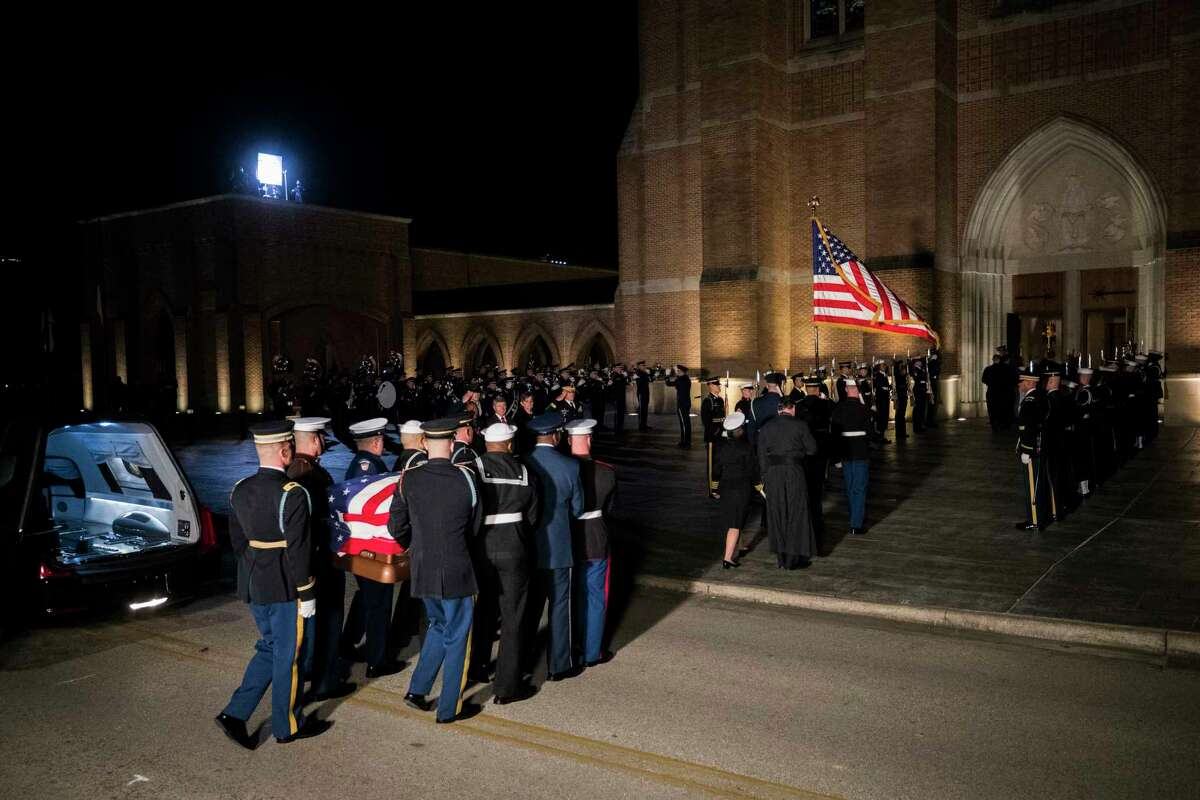 Military personnel perform the arrival ceremony at St. Martin's Episcopal Church where former President George H.W. Bush will lie in repose, Wednesday, Dec. 5, 2018, in Houston.