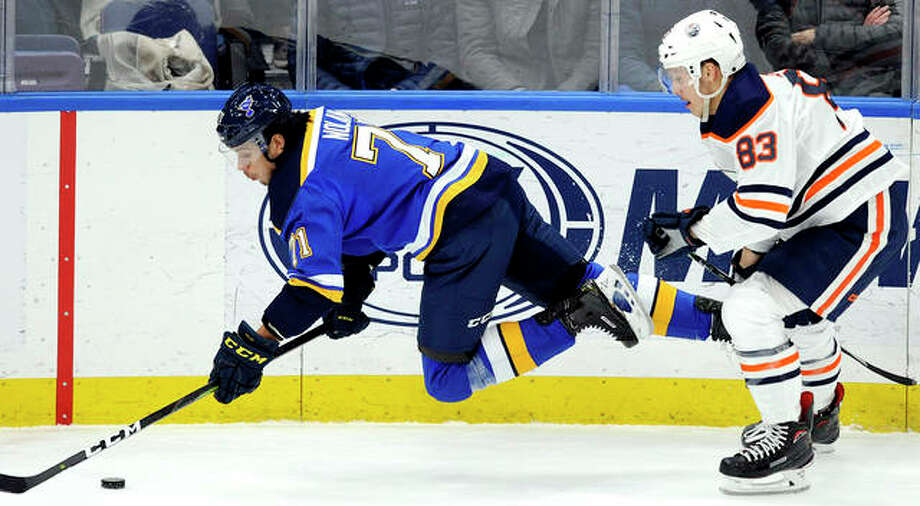 The Blues' Jordan Nolan (71) dives for the puck in front of Edmonton Oilers' Matt Benning (83) Wednesday night in St. Louis. Photo: Bill Boyce | AP Photo