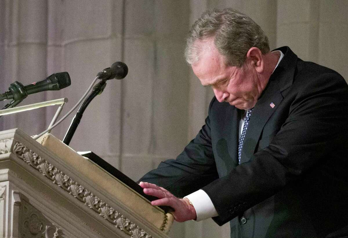 Former President George W. Bush becomes emotional as he speaks at the State Funeral for his father, former President George H.W. Bush, at the National Cathedral, Wednesday, Dec. 5, 2018, in Washington. (AP Photo/Alex Brandon, Pool)