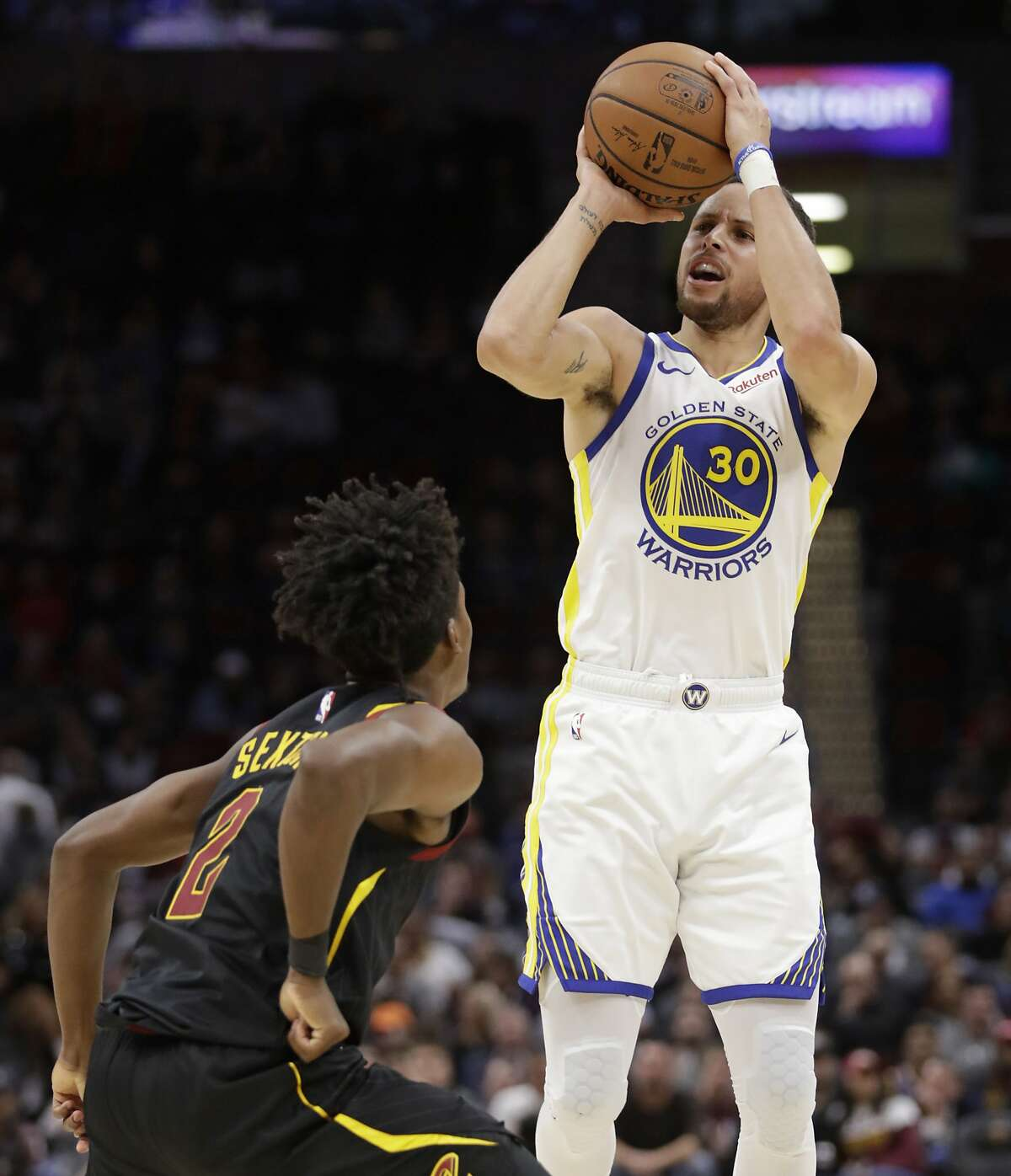 Golden State Warriors' Stephen Curry (30) shoots over Cleveland Cavaliers' Collin Sexton (2) in the second half of an NBA basketball game, Wednesday, Dec. 5, 2018, in Cleveland. (AP Photo/Tony Dejak)