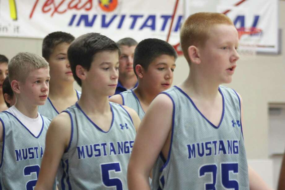 A junior high team from Friendswood goes through the postgame greetings at Phillips Fieldhouse, following a San Jacinto Invitational Tournament game some five years ago. Photo: Robert Avery