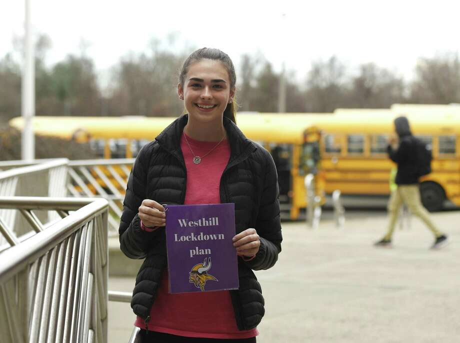 Westhill senior Lauren Klym shows her lockdown plan outside Westhill High School in Stamford, Conn. Monday, Dec. 3, 2018. Klym was inspired to take action after the Parkland shootings and began working on a lockdown procedure checklist for subs and teachers in new classrooms. Klym's project was so well done, Stamford police adopted it districtwide and it was recently acknowledged by the Stamford Board of Education. Photo: Tyler Sizemore / Hearst Connecticut Media / Greenwich Time