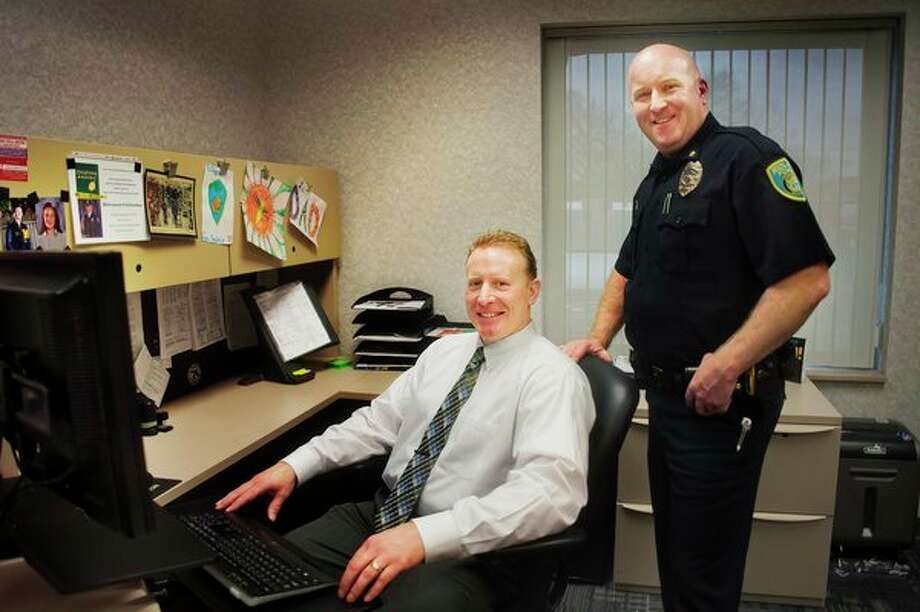 Midland Deputy Chief of Police Rodney Roten, right, whose last day on the job is Monday, and Detective Lt. Marc Goulette, left, who will replace Roten as deputy chief, pose Wednesday for a portrait inside Roten's office at the Midland Law Enforcement Center. (Katy Kildee/kkildee@mdn.net)