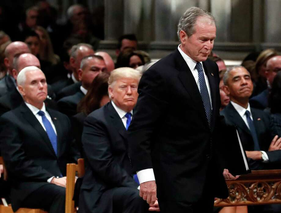 Former President George W. Bush walks past President Donald Trump and former President Barack Obama to speak a State Funeral for President George H.W. Bush, at the National Cathedral, Wednesday, Dec. 5, 2018, in Washington. Vice President Mike Pence is at left. Photo: Alex Brandon, AP / Copyright 2018 The Associated Press. All rights reserved.