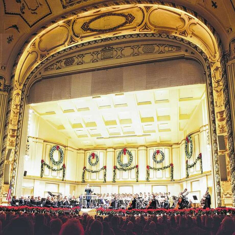 """The St. Louis Symphony Orchestra performs at its home in St. Louis' Powell Hall, which is decorated for the season. The orchestra will perform Handel's """"Messiah"""" this weekend at the concert hall. Photo: Handout Photo"""