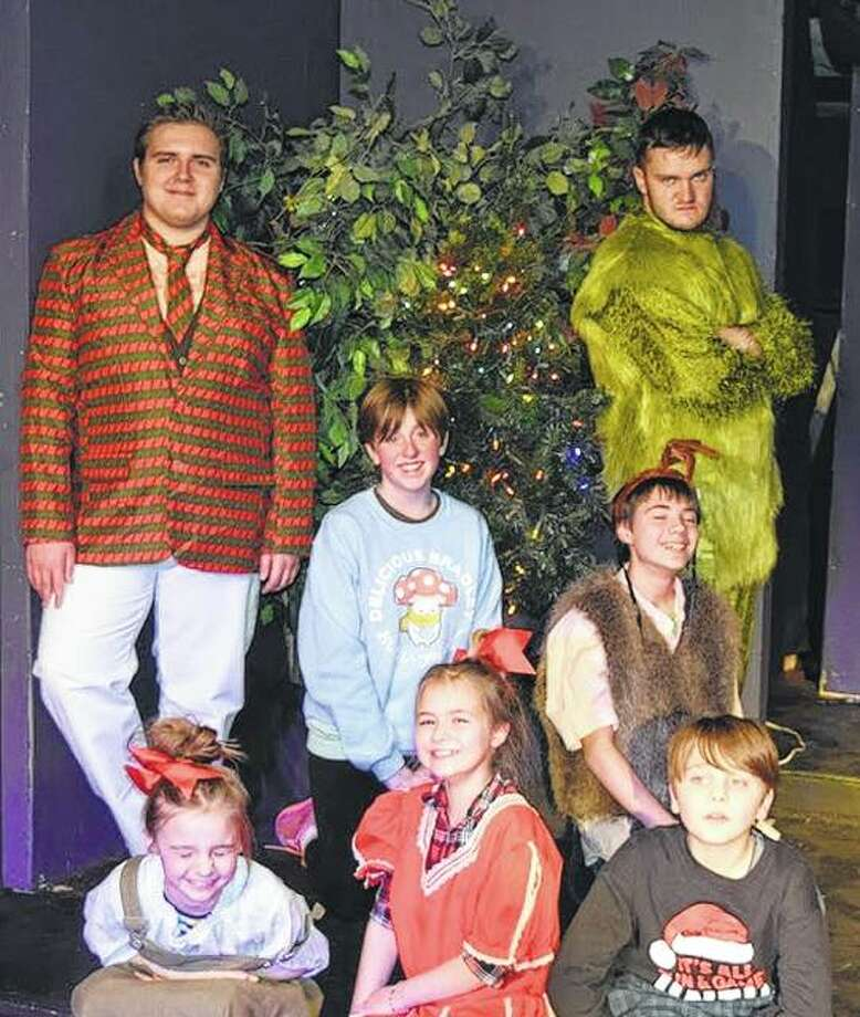 "An ""exaggerated"" reader's theater production of ""How the Grinch Stole Christmas"" will be staged this weekend at Playhouse on the Square. Featured performers include Willem Klein (back row, from left) as the narrator, Liz Barker-Devine as Who 1, Carson Cole as Max, Mason Durdel as The Grinch, Lexie Cole (front, from left) as Who 2, McKenzie McGee as Cindy Lou Who, and Morgan Cole as Who 3. Photo: Photo Provided"