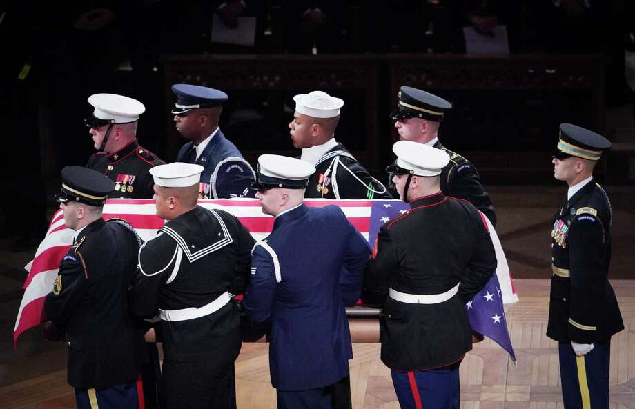 Allon C. Louisgene, a U.S. Navy sailor from Milford, Conn., was part of the military honor guard that carried the flag-draped casket of former President George H.W. Bush out after the State Funeral at the National Cathedral, Wednesday, Dec. 5, 2018, in Washington. Louisgene is the third member in the top row wearing the sailor's cap. Photo: MANDEL NGAN / AFP /Getty Images / AFP or licensors