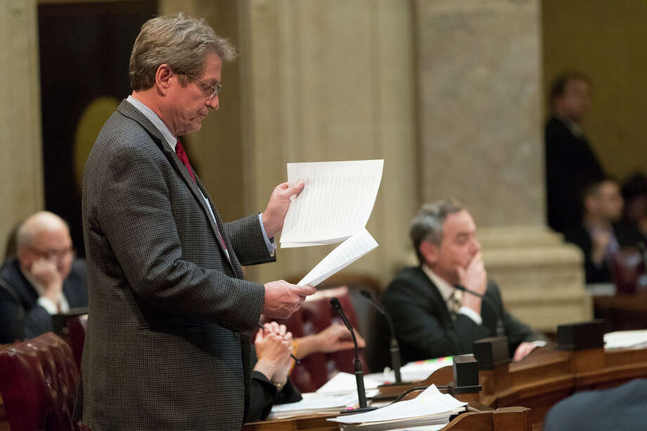 State Sen. Tim Carpenter, left, D-Milwaukee, questions a list of about fifty appointment referrals submitted to the State Senate at the Capitol in Madison, Wis., Tuesday, Dec. 4, 2018. Demonstrators booed outgoing Wisconsin Gov. Scott Walker on Tuesday during the Christmas tree-lighting ceremony, at times drowning out a high school choir with their own songs in protest of a Republican effort to gut the powers of his Democratic successor. (Mark Hoffman/Milwaukee Journal-Sentinel via AP) Photo: Mark Hoffman / Milwaukee Journal Sentinel