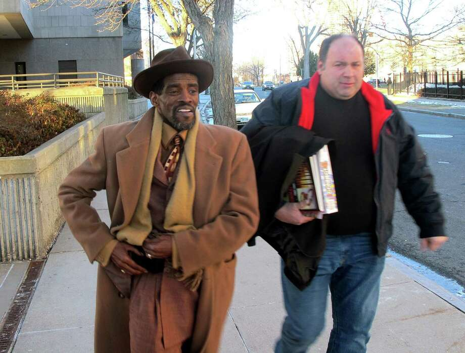 Former State Sen. Ernie Newton, left, leaves Hartford Superior Court on Friday, Jan. 16, 2015. Newton was found guilty on three charges of illegal practices in campaign financing and acquitted on a charge of tampering with a witness. The jury was unable to reach a verdict on four other charges--two more counts of illegal practices in campaign financing and two counts of first-degree larceny. With Newtown is his friend, Chris Taylor. Photo: Michael P. Mayko / Michael P. Mayko / Connecticut Post