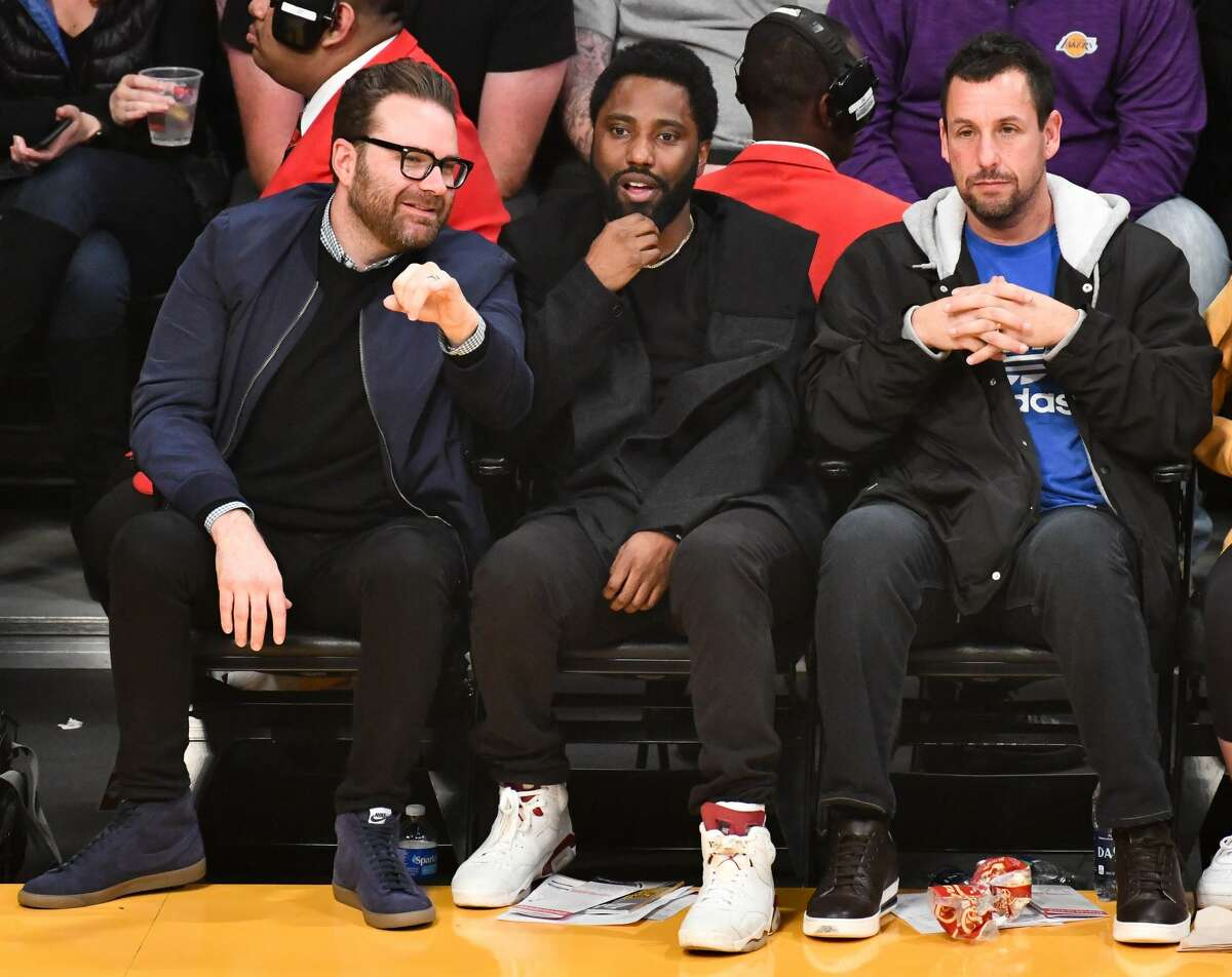 LOS ANGELES, CALIFORNIA - DECEMBER 05: (L-R) Producer Eddie Vaisman, actor John David Washington and Adam Sandler attend a basketball game between the Los Angeles Lakers and the San Antonio Spurs at Staples Center on December 05, 2018 in Los Angeles, California. (Photo by Allen Berezovsky/Getty Images)