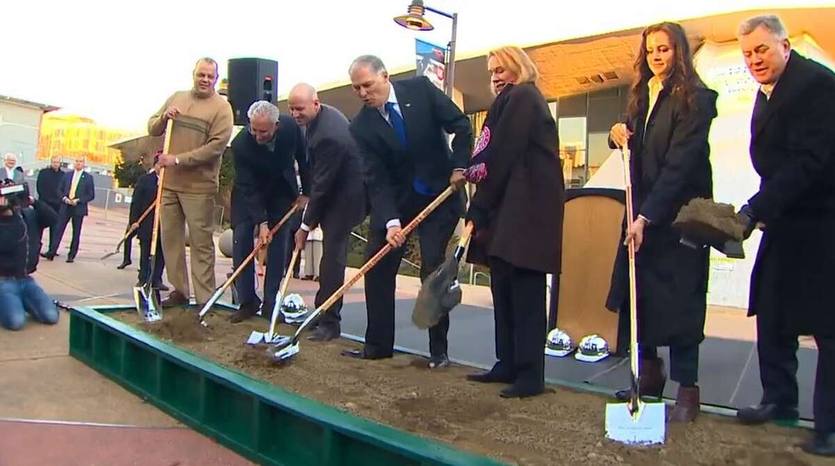Mayor Jenny Durkan, Governor Jay Inslee and members of NHL's Seattle's management break ground on a new Seattle Center arena.