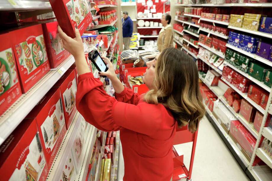 FILE- In this Nov. 16, 2018, file photo Target employee Lindsay Walker scans an item as she collects merchandise from shelves to prep them for an online order at a Target store in Edison, N.J. On Thursday, Dec. 6, the Institute for Supply Management, a trade group of purchasing managers, issues its index of non-manufacturing activity for November. Photo: Julio Cortez, AP / Copyright 2018 The Associated Press. All rights reserved.