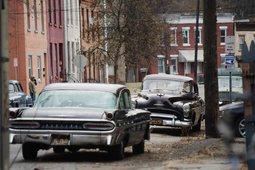 Click through to see a slideshow of movies filmed in the Capital Region. Vintage cars are parked along Jefferson Street in Troy for the filming of a street scene for a movie being shot on Thursday, Dec. 6, 2018. (Paul Buckowski/Times Union)