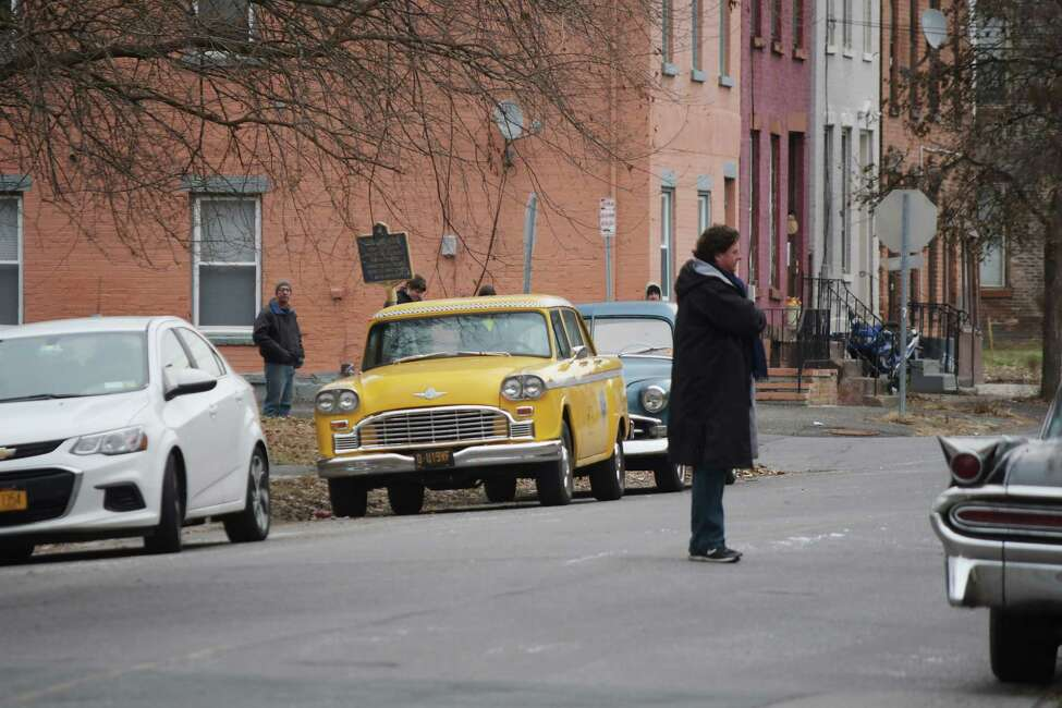 Older style vehicles are seen parked along Jefferson Street for the filming of a street scene for a movie being shot on Thursday, Dec. 6, 2018, in Troy, N.Y. (Paul Buckowski/Times Union)