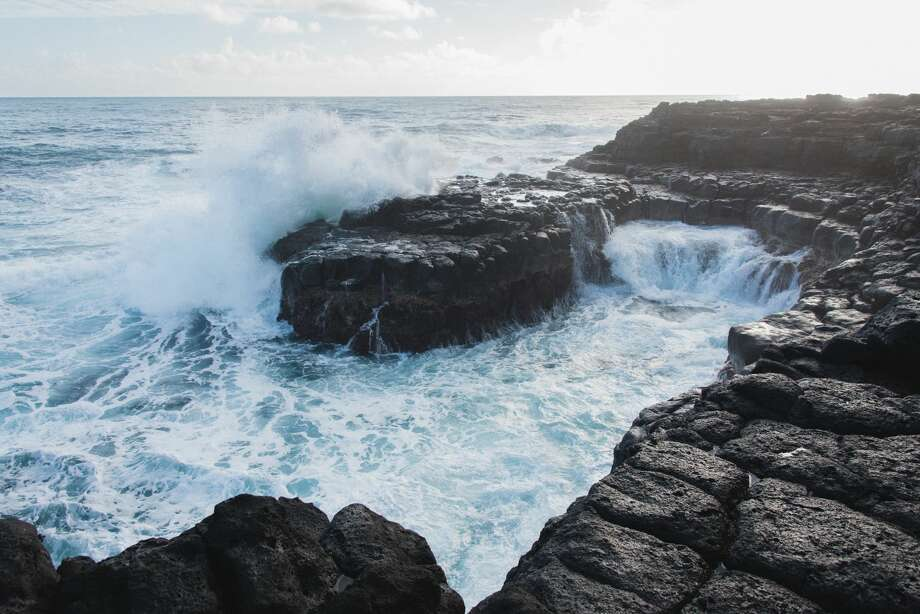 The Queen's Bath is a natural pool by the sea formed by lava rock and ocean water in Princeville on Kauai's North Shore. When the surf is high, it's a dangerous place. Photo: Matt Wunder/Getty Images/iStockphoto