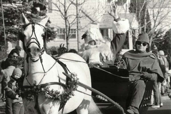 Even Santa's horse was smiling as the jolly old elf arrives in Midland for the Santa Holiday Parade. (November 1986)