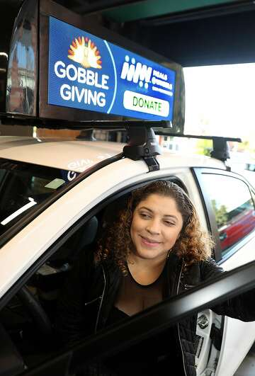 Rooftop video ads bring extra cash for Uber, Lyft drivers