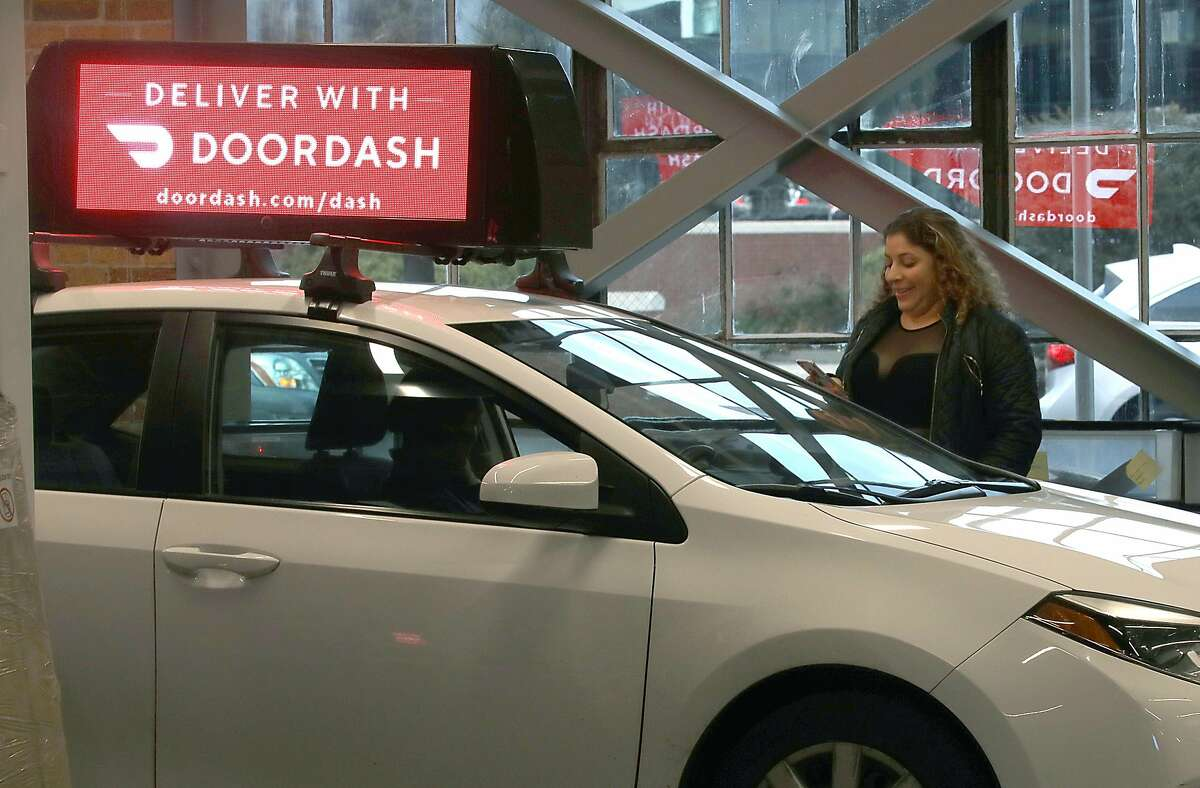 Uber and Lyft driver Jackeline Arana has her car outfitted with a video display at Firefly.