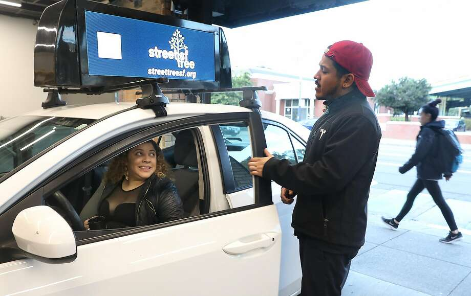 Firefly makes video advertising screens to place on top of Uber/Lyft cars. Photo: Liz Hafalia / The Chronicle