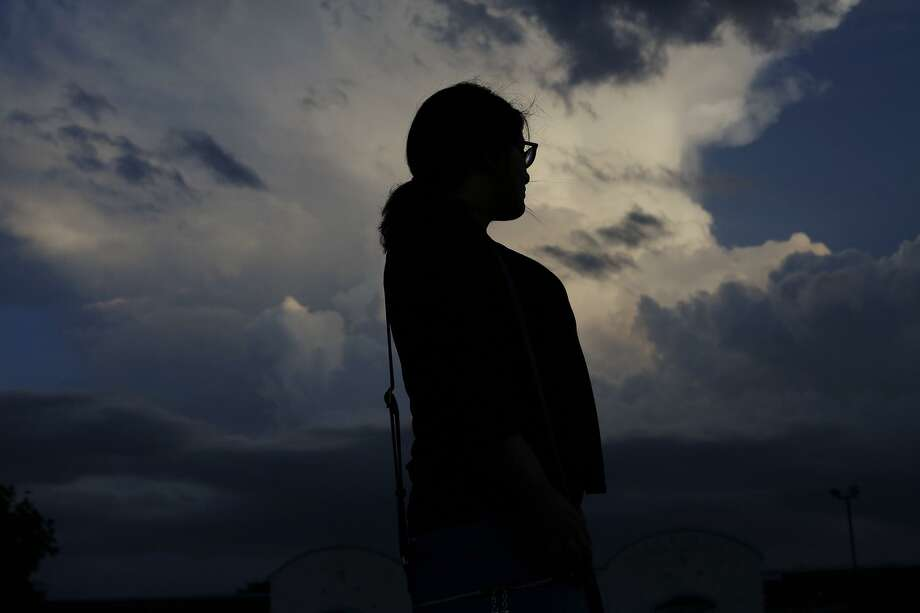 Rene, 18, who was trapped into sex-trafficking by a pimp at age 14, sits in a park in San Antonio last May. Photo: Lisa Krantz /San Antonio Express-News / San Antonio Express-News