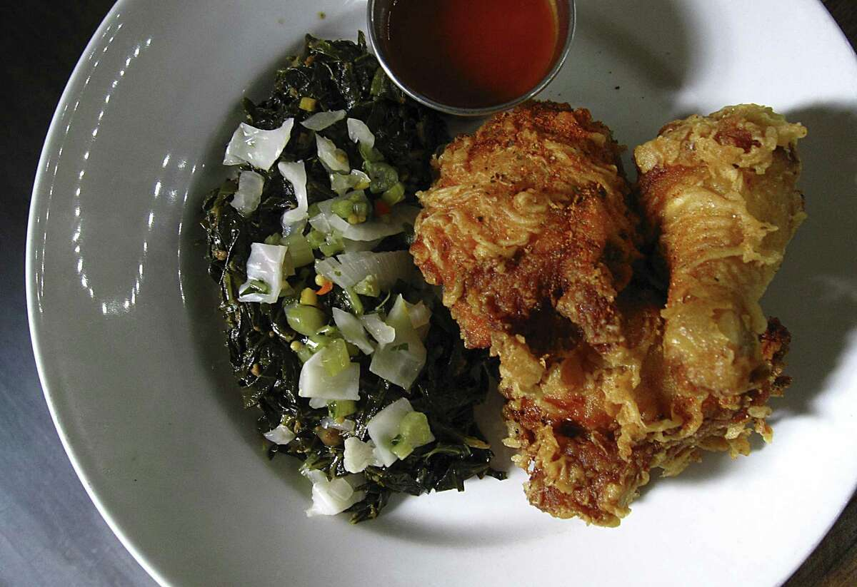 Fried chicken with braised greens, collard stem chow-chow and honey hot sauce from Meadow Neighborhood Eatery + Bar