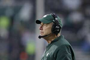 Michigan State coach Mark Dantonio watches the from the sideline during an NCAA college football game against Rutgers, Saturday, Nov. 24, 2018, in East Lansing, Mich. (AP Photo/Al Goldis)