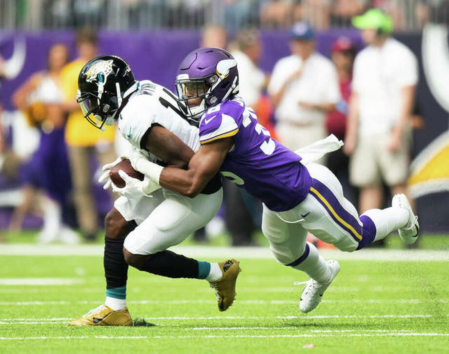 Minnesota Vikings cornerback Craig James, right, tackles a Jacksonville Jaguars player during a preseason game on Aug. 18. James, a 2014 Edwardsville High School graduate, made his NFL regular season debut against the New England Patriots last Sunday.