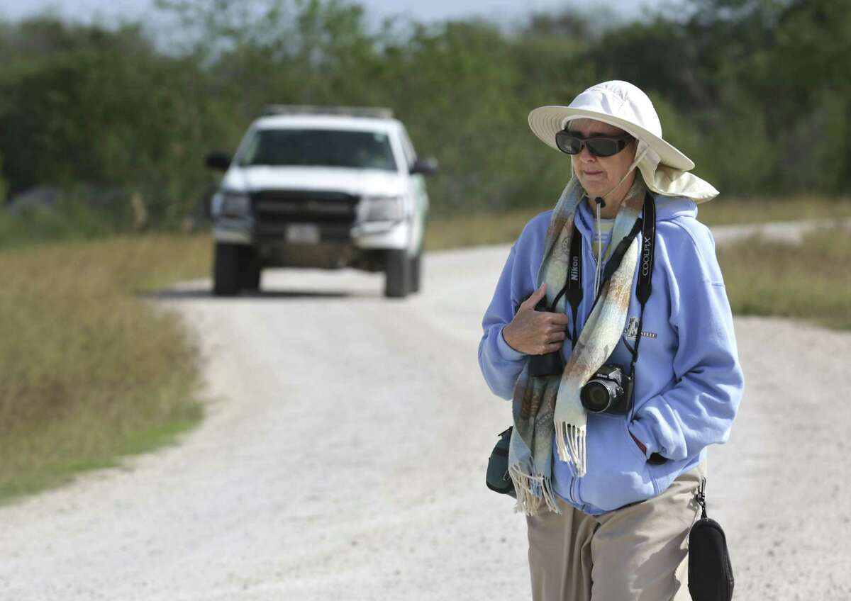 Mission resident Joanne Mozynski, an avid birder, looks for the Roadside Hawk that was seen recently along the levee at the National Butterfly Center. A Border Patrol vehicle behind her patrols along the levee. Border wall plans would cut The National Butterfly Center in half. The first signs of border wall construction were spotted this weekend at National Butterfly Center.