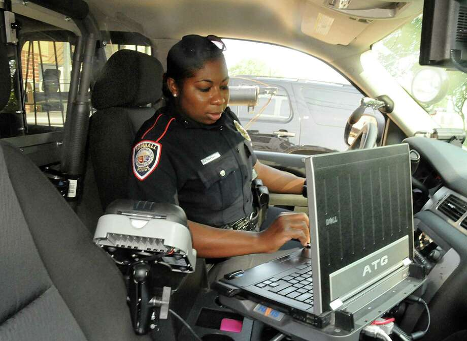 Tomball Police Department officer Cleo Thomas checks the computer in her patrol SUV as she prepares to leave on patrol. The Tomball City Council approved the purchase of a new computer assisted dispatch on Monday. Photo: David Hopper, Freelance / For The Chronicle / freelance
