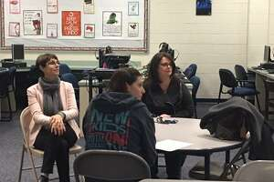 Parents listen to a presentation by ACES at Mead School, Ansonia, on Tuesday, Dec. 4, 2018
