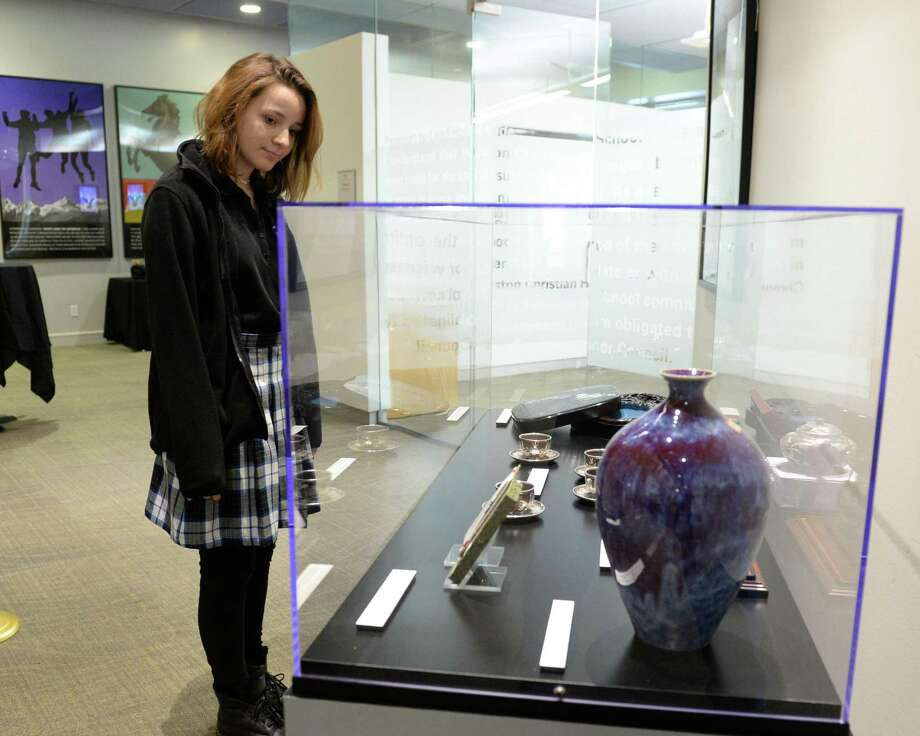 Student Ashley Egger views items on loan from the George H. W. Bush Presidential Library being displayed at The George and Barbara Bush Center for Scholars and Leaders, Houston Christian High School, Wednesday, Dec. 5, in Houston. Photo: Craig Moseley, Houston Chronicle / Staff Photographer / ©2018 Houston Chronicle