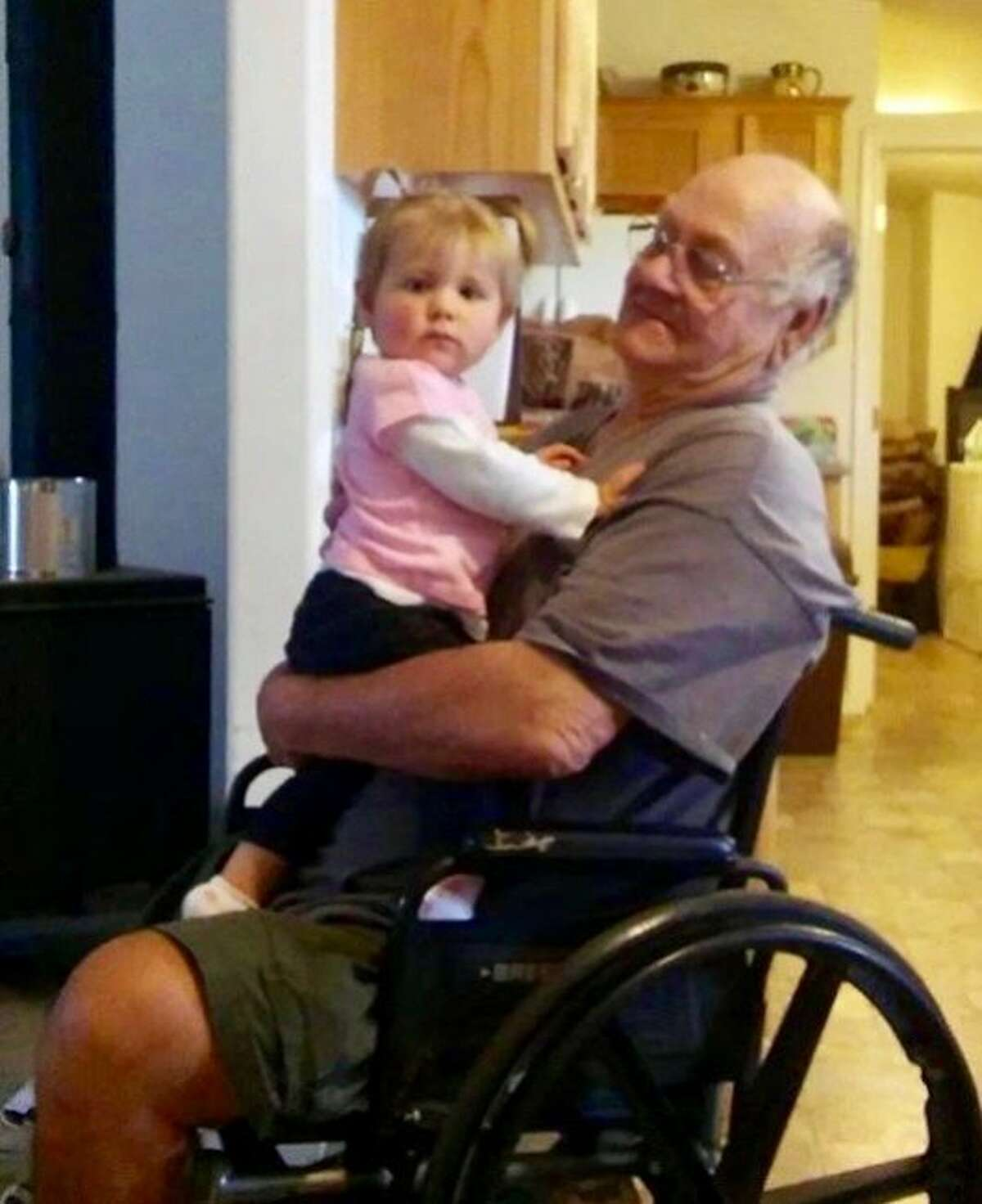 TK Huff, 71, with his great-granddaughter Layla.