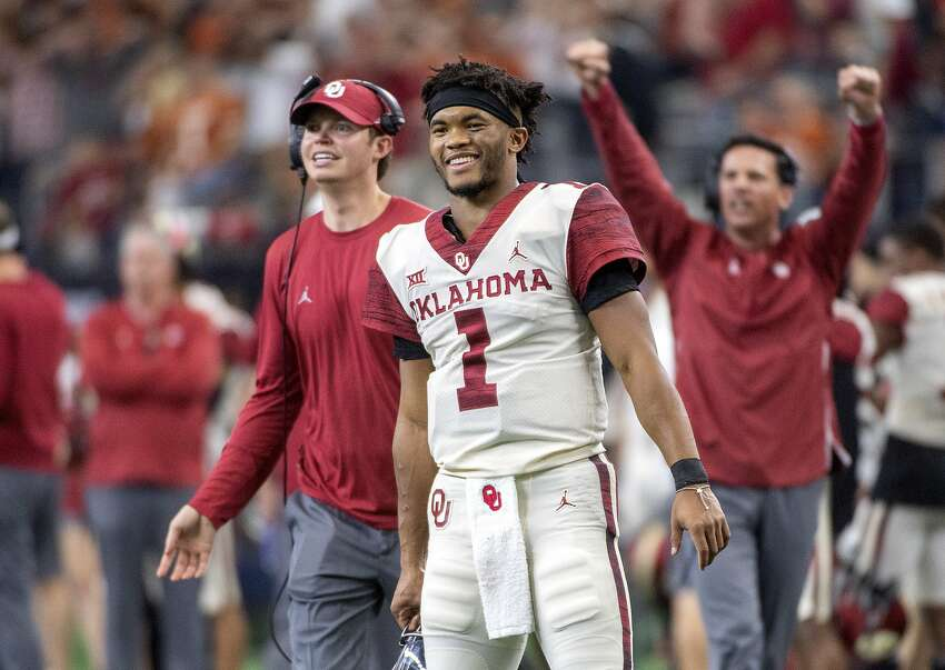 FILE - In this Dec. 1, 2018, file photo, Oklahoma quarterback Kyler Murray (1) celebrates on the sidelines after throwing a touchdown against Oklahoma during the second half of the Big 12 Conference championship NCAA college football game, in Arlington, Texas. Murray was named The Associated Press college football Player of the Year, Thursday, Dec. 6, 2018. (AP Photo/Jeffrey McWhorter, File)