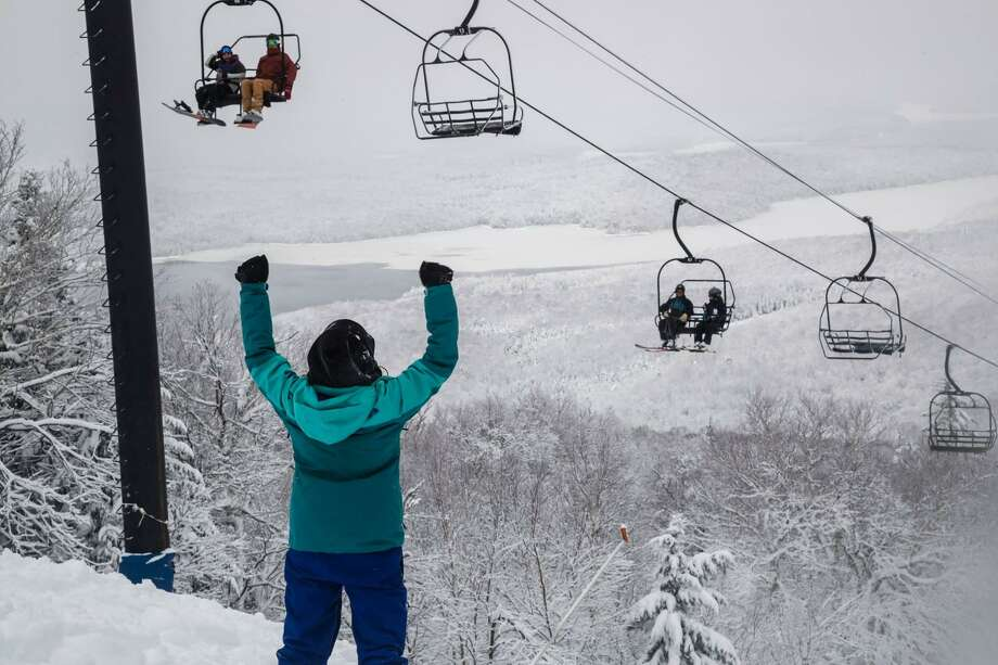 A snowboarder stands on top of the Mount Snow's North Face before heading down the trail. On Thursday, Dec. 6, 2018, the southern Vermont ski resort had 40 trails open. This weekend, more southern New England and New York state areas will begin the season. Photo: Mount Snow Photo /Facebook