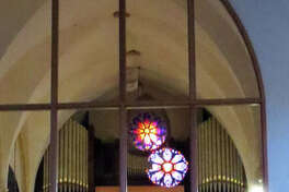 "The old and the new meet at St. Boniface Church in Edwardsville as the rose window from the new addition to the church is reflected under the rose window from the old church. St. Boniface Church is celebrating its 150th anniversary in 2019, with the ""Year of Jubilee"" celebration."