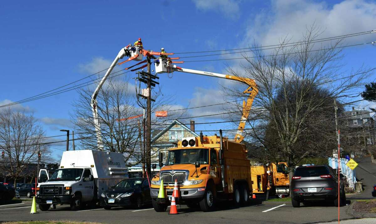 Eversource technicians work on lines in early December 2018 in Norwalk, Conn.