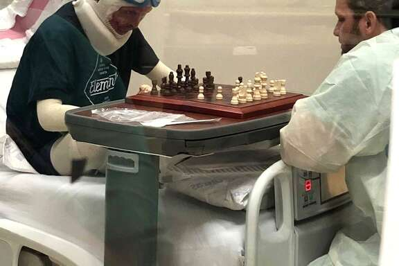 Zachary Sutterfield, 20, of San Angelo, continues to recover from critical injuries he suffered in a catastrophic apartment fire that killed five people in San Marcos in July. He recently played chess with one of his nurses at the U.S. Army Institute of Surgical Research Burn Center at Joint Base San Antonio-Fort Sam Houston.