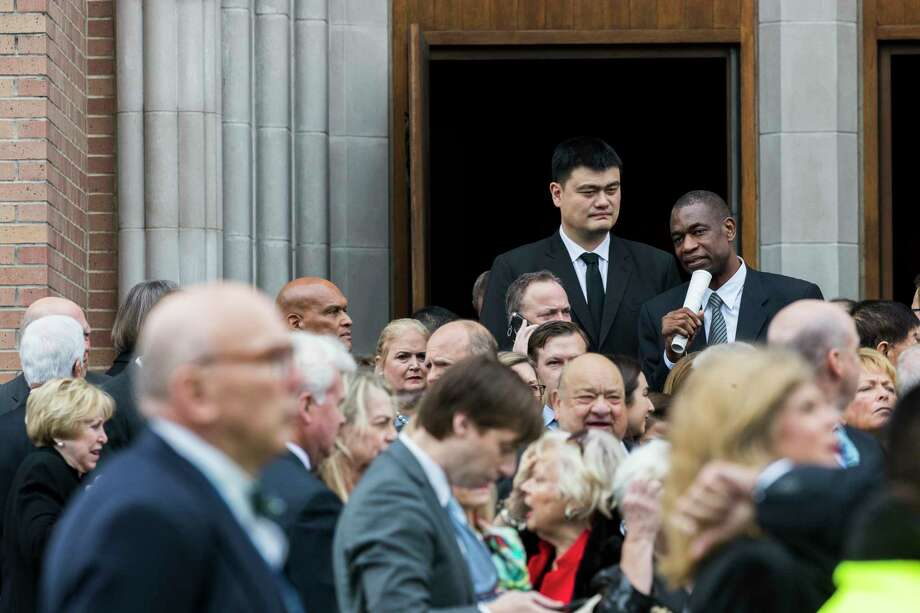 Houston Rockets' former players Yao Ming, from left, and Dikembe Mutombo wait in line to board a shuttle from St. Martin's Episcopal Church to Second Baptist Church after the funeral of former President George H.W. Bush on Thursday at St. Martin's Episcopal Church, Dec. 6, 2018, in Houston. Photo: Marie D. De Jesús, Staff Photographer / © 2018 Houston Chronicle