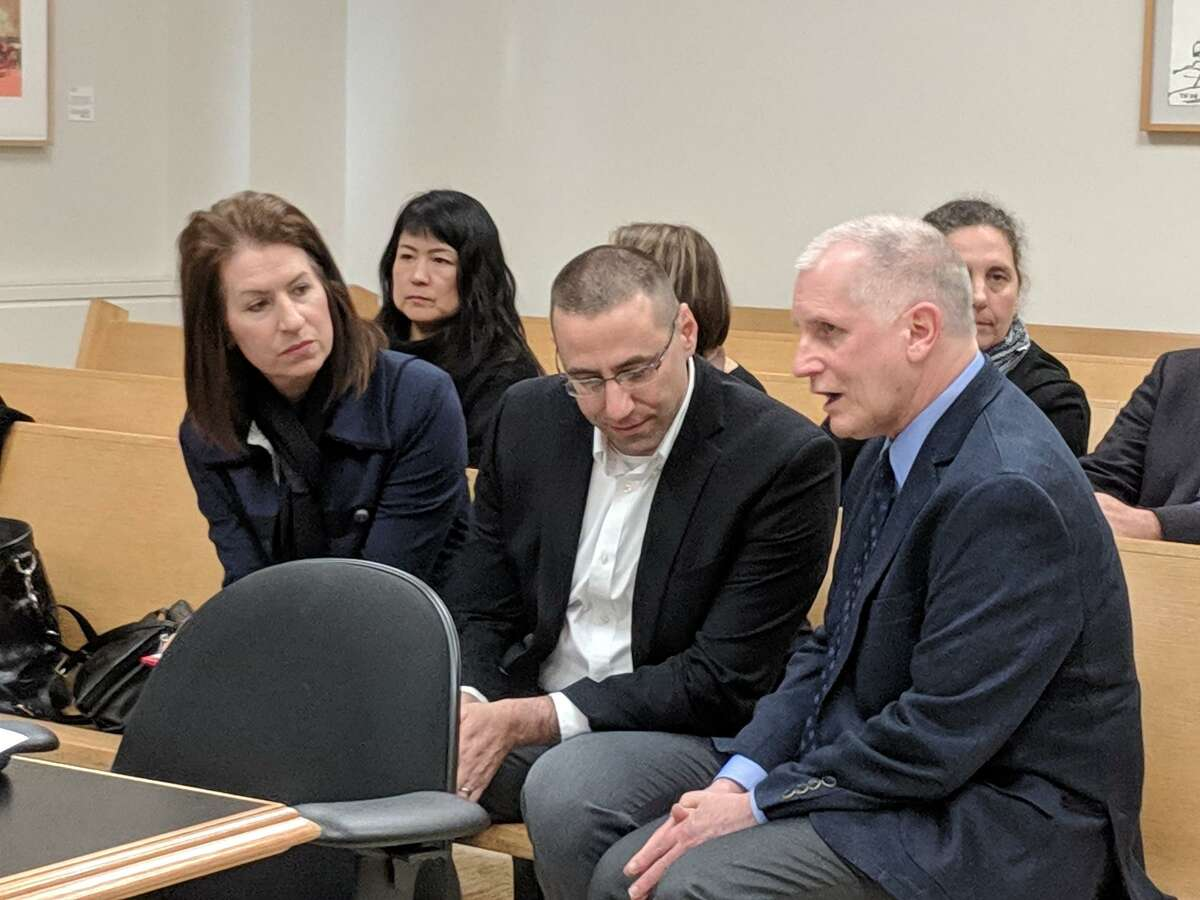Charles Peters, center, is flanked by his attorneys Jennifer Cannon-Union, left, and James Dixon, right, after he was given 3 1/2 years in prison Thursday morning for running an online platform in Bellevue to sell prostitution. His punishment is postponed pending the outcome of his appeal.