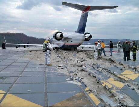 2010 photo from Charleston, WV runway overrun. The engineered material arresting system – or EMAS – uses crushable concrete placed at the end of a runway to stop an aircraft that overruns the runway. The tires of the aircraft sink into the lightweight concrete and the aircraft is decelerated as it rolls through the material Photo: Engineered Arresting Systems Corporation