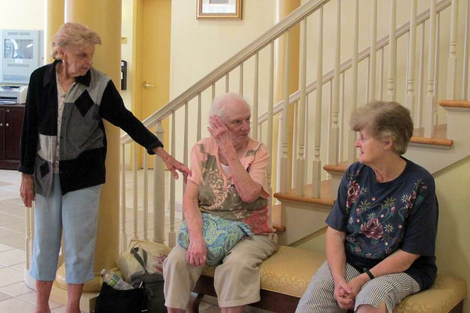 Helen Matulavage, left, with two other residents from the Callahan House senior housing in Seymour during the summer of 2011. Matulavage, whose daughter helped prompt state legislation on housing complex violence, died in 2017. Photo: Monica Szakacs / ST / Connecticut Post staff photo